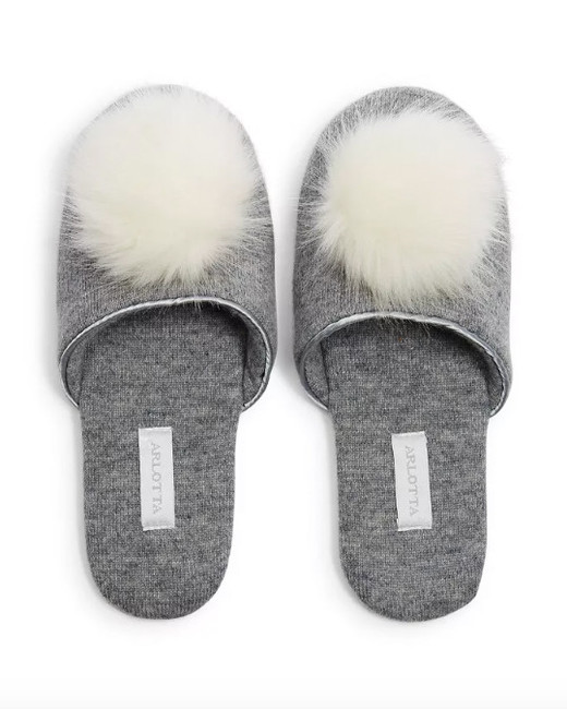 gray slippers with fuzzy ball