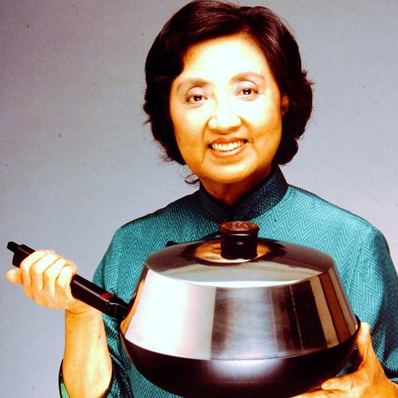 Joyce Chen holding a wok