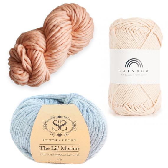 yarn collage with blue ball stitch story off white skein hobbii soft orange skein purlsoho