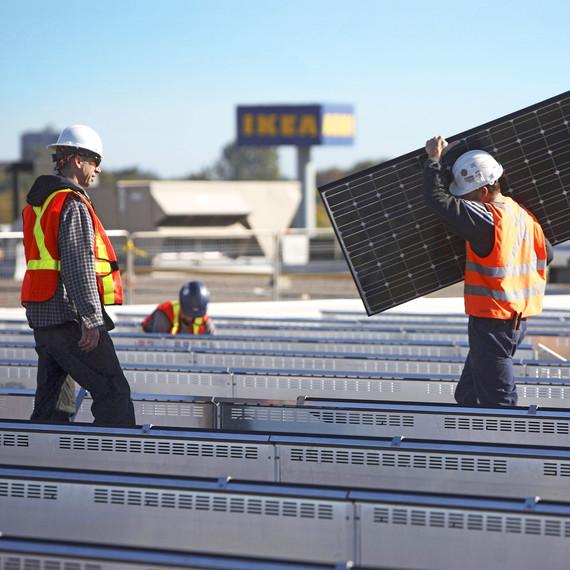 Ikea installing solar panels on rooftop