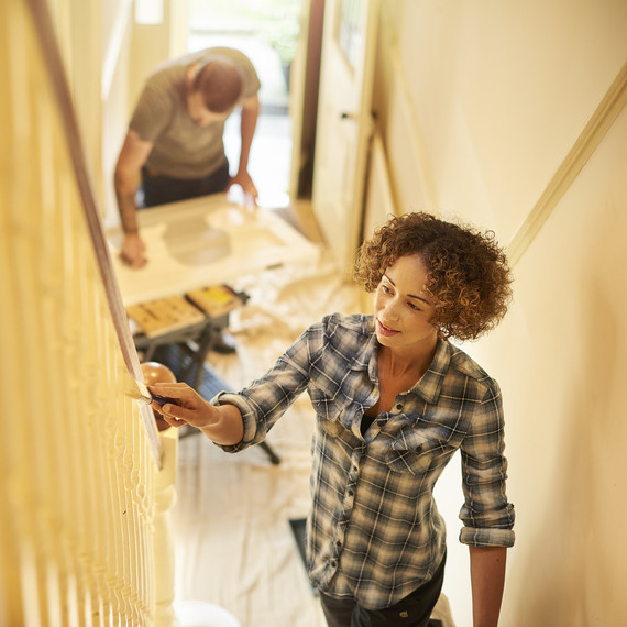 A couple renovate and paint their home.
