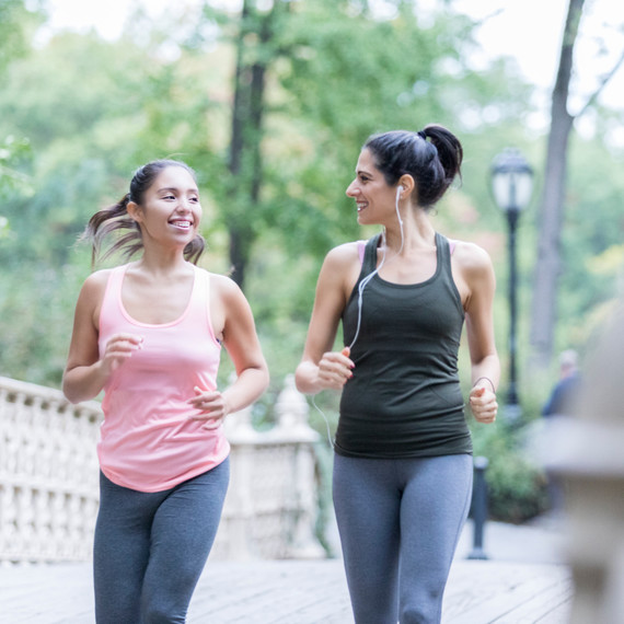 Two women walking in a park to exercise.