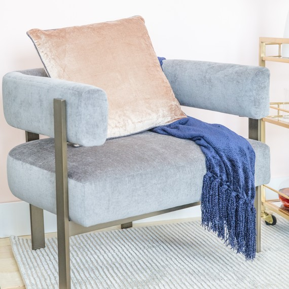 comfy chair, throw, and pillow