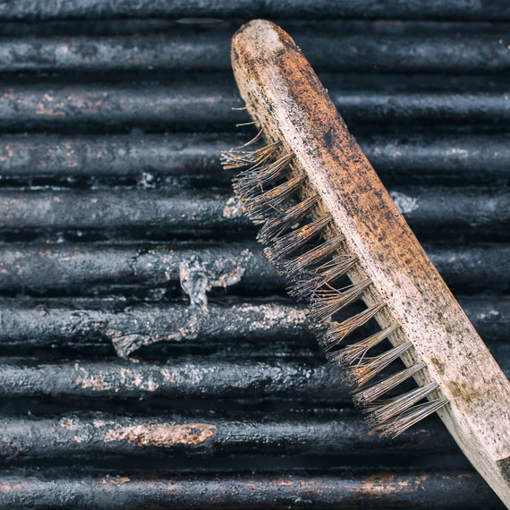 Used Grill Brush With Bristles on Grille