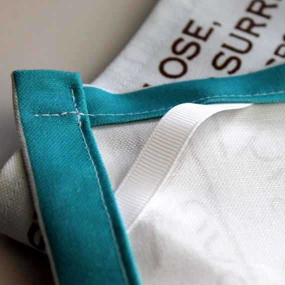 Sew a small length of twill tape sewn into the corner to hang your tea towel from a hook.