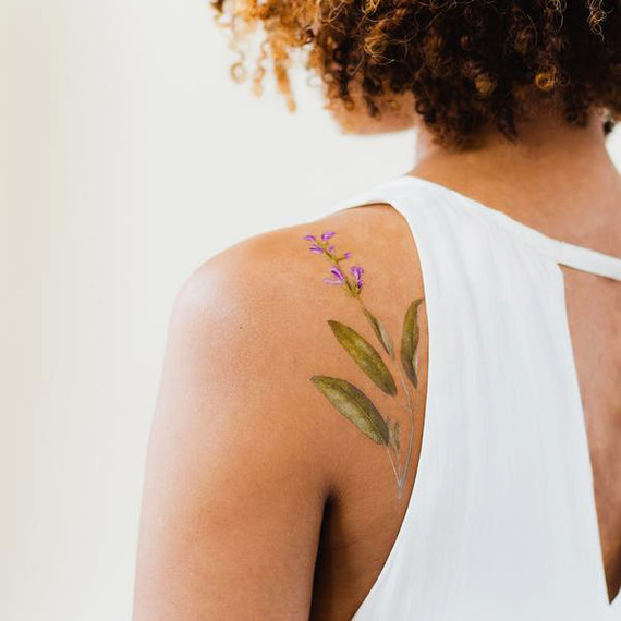 scented herb back tattoo