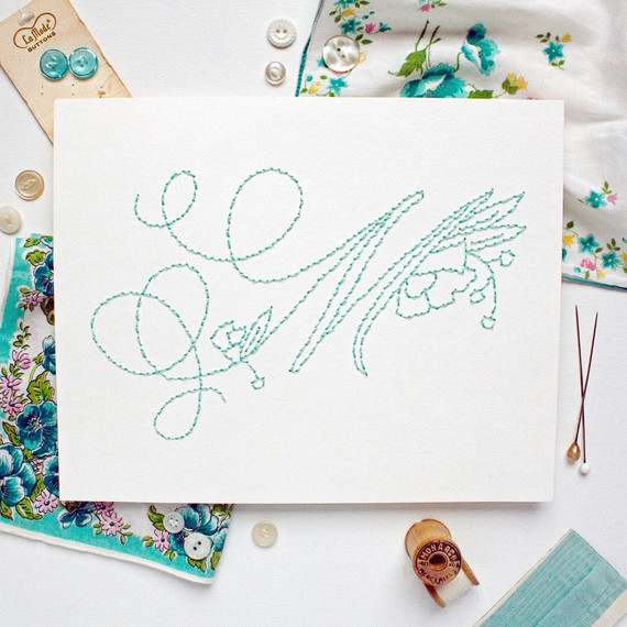 embroidered teal monogram