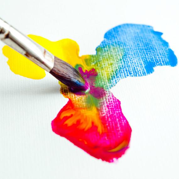 A paintbrush mixing watercolors
