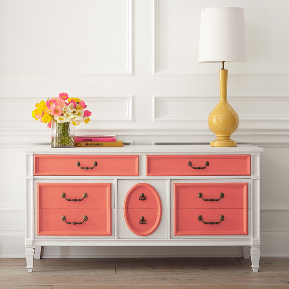 salmon coral dresser with yellow lamp