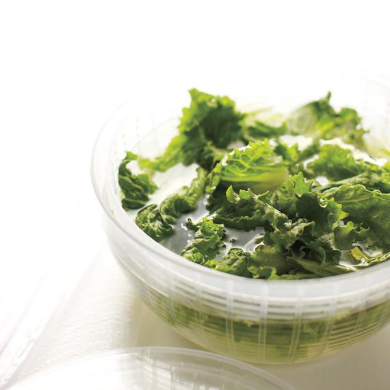 prepping lettuce in bowl