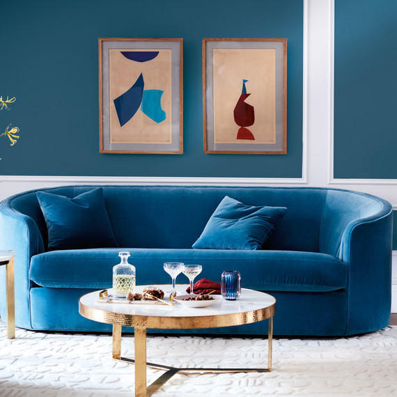 blue sofa and green armchair