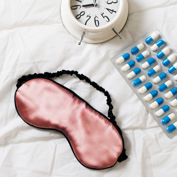 sleep mask sleeping pills and clock