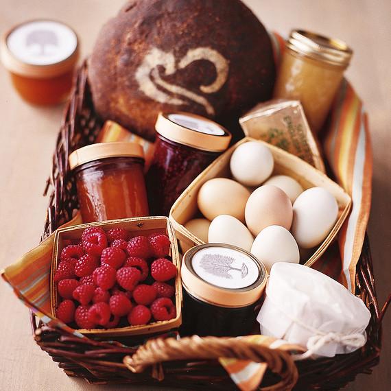 jams raspberries and eggs in a basket