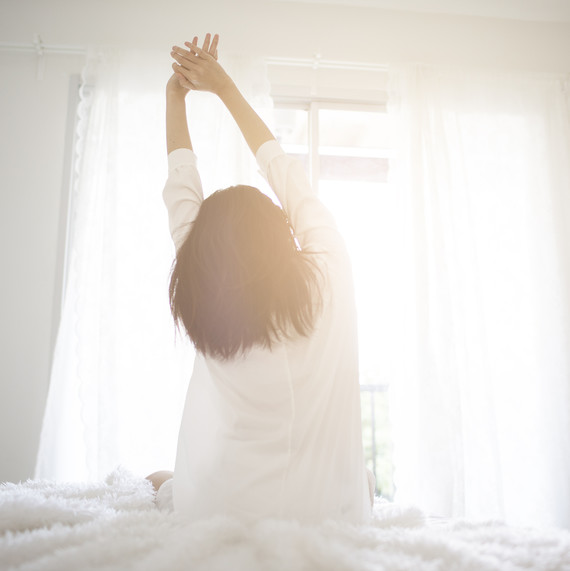 woman-waking-up-sunlight-0518