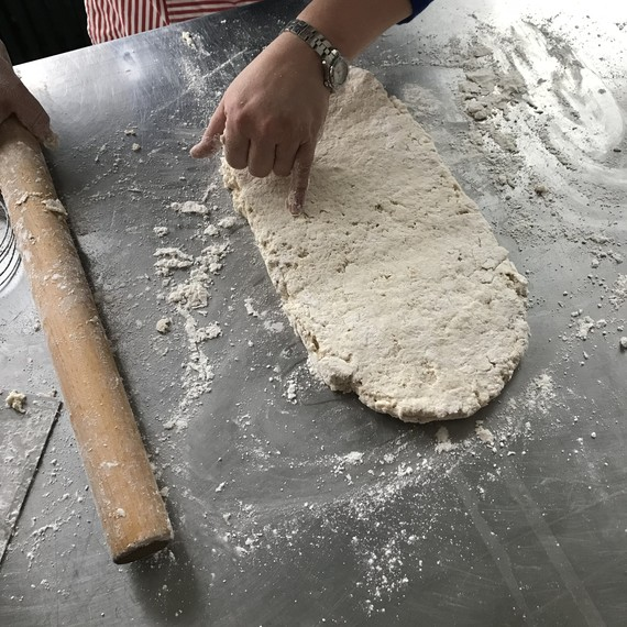 rolling cathead biscuit dough