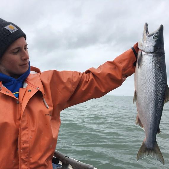 fishers holding salmon