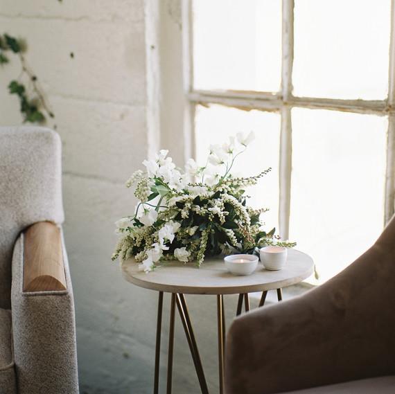 LA summer brunch flowers on side table