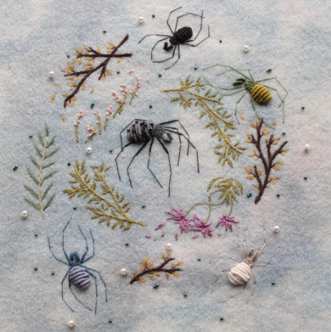 embroidered spiders