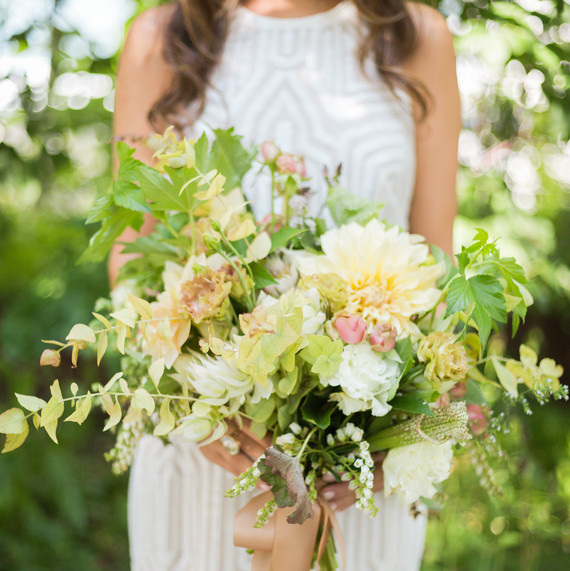 holding-bouquet-flowers-outdoors