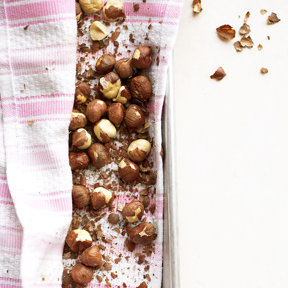 hazelnuts on pan with pink striped cloth