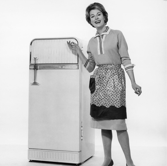 woman posing in front of vintage fridge