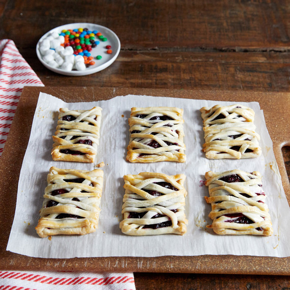 mummy hand pie pastries on cutting board with striped cloth