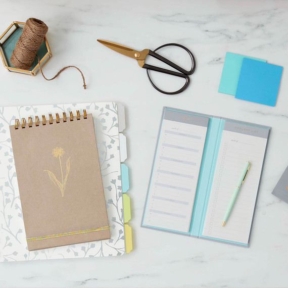 blue and white menu planner on marble desk