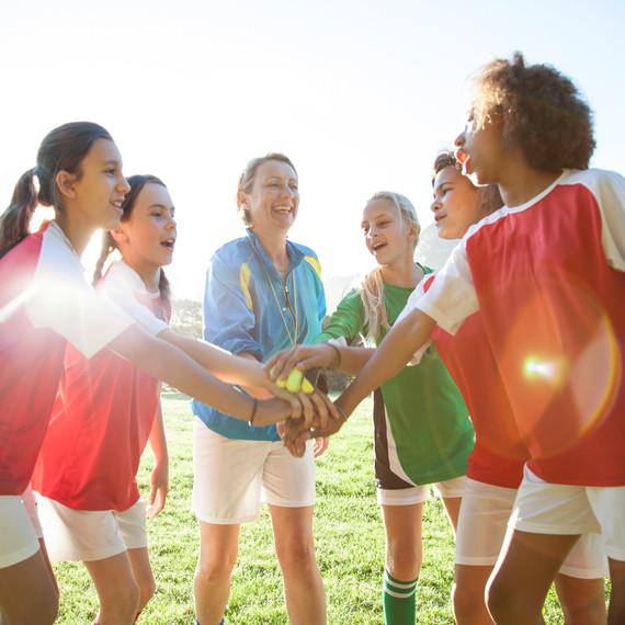 girls teamwork hands in