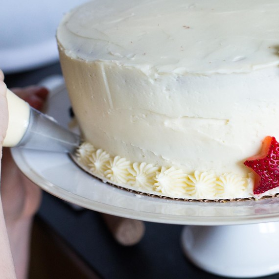 Use a star tip to pipe a border around the cake