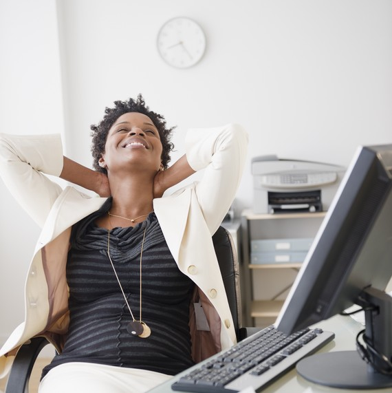 Five Stretches You Can Do While Sitting at Your Desk—Plus, Why It's So Important