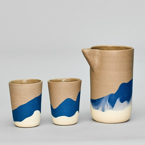 tan blue and cream ceramic pitcher and cups