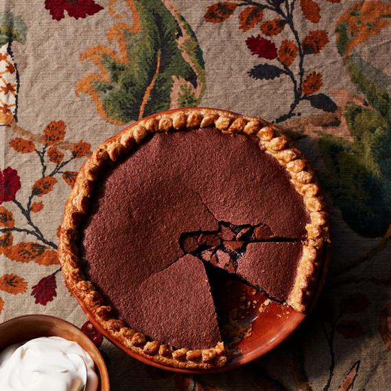 chocolate chess pie sliced in orange platter