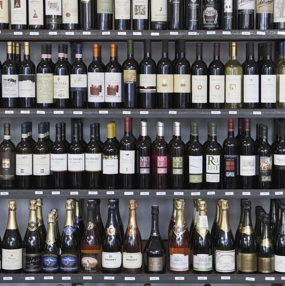 shelves full of wine bottles in wine store
