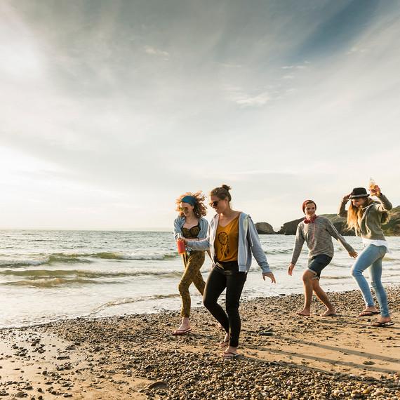 Group of Friends Walking on Beach