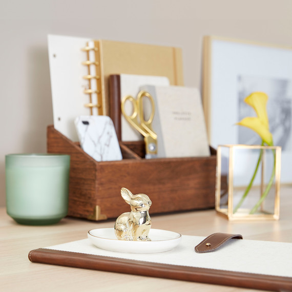 gold bunny tray on desk
