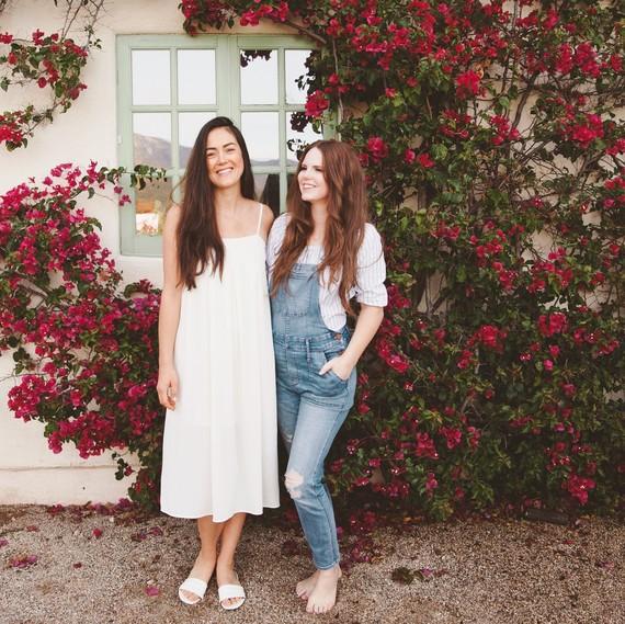 sweet laurel retreat women standing by house