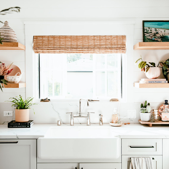 white kitchen with wood blinds and open shelving