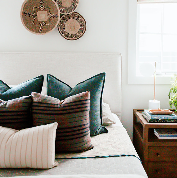 guest bedroom with basket wall decor