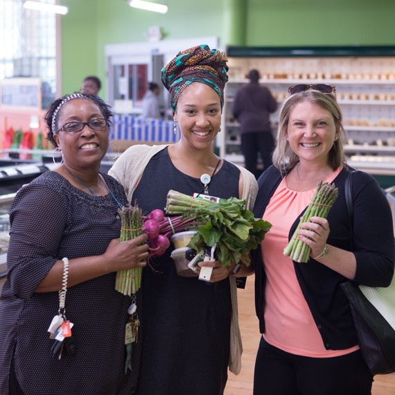 women with fresh produce at Daily Table store