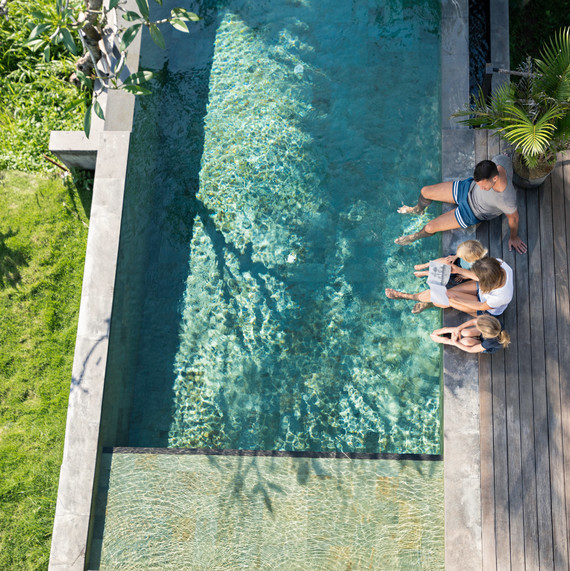 family next to swimming pool