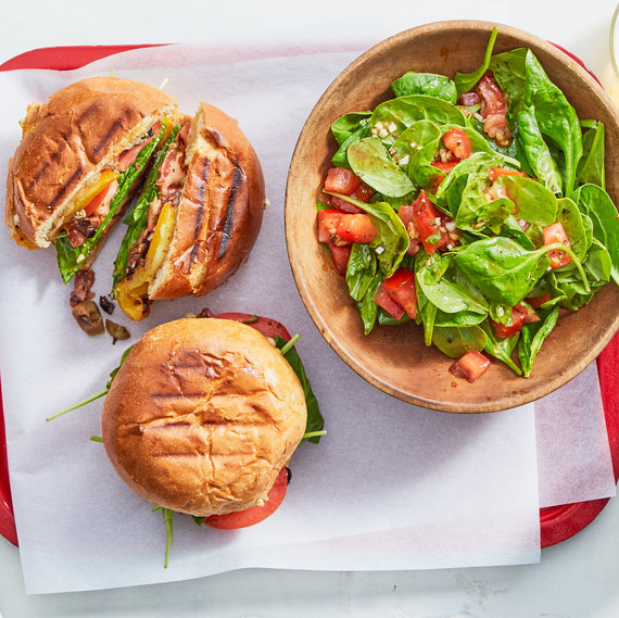 two burgers with spinach salad