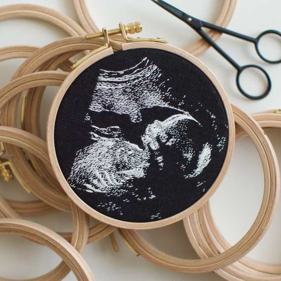 Embroidered sonogram imagery in a hoop.