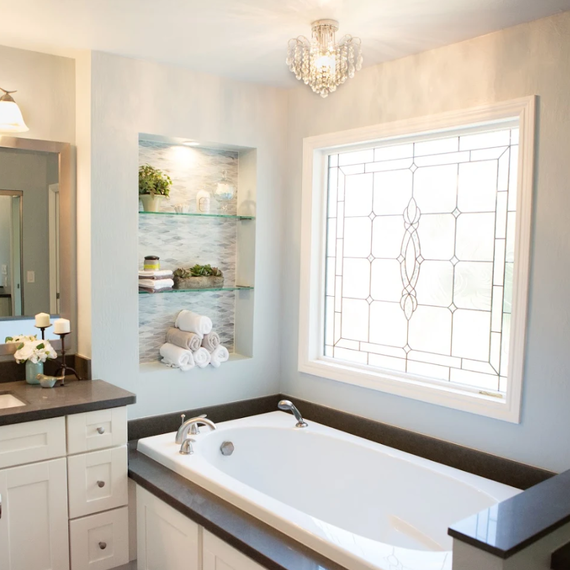 bathroom makeover with large custom window over bathtub
