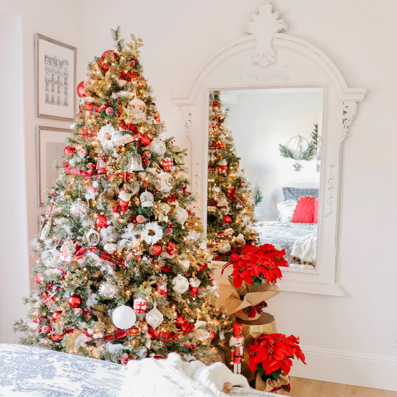christmas tree and holiday decor in master bedroom