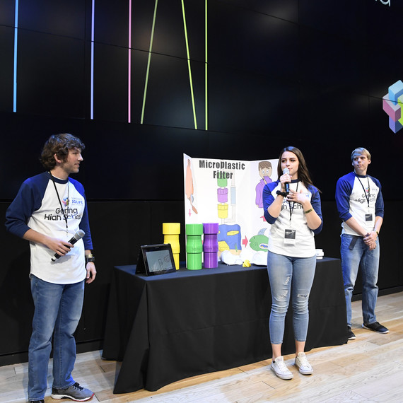 students present microplastic filter