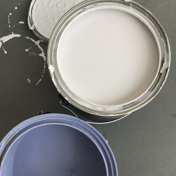 white and blue paint cans