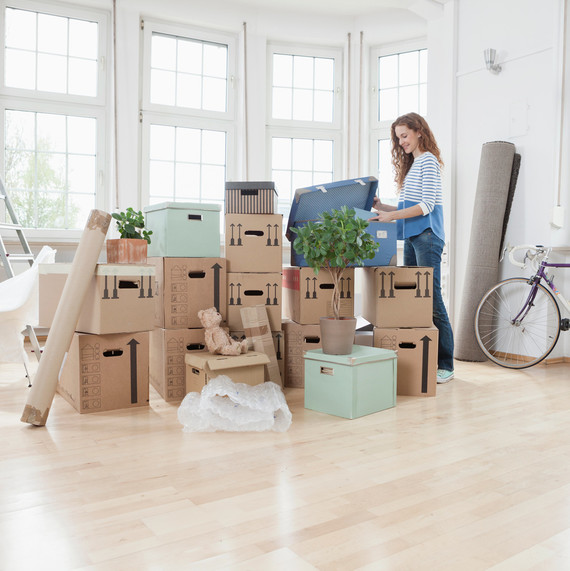 woman unpacking boxes in new apartment