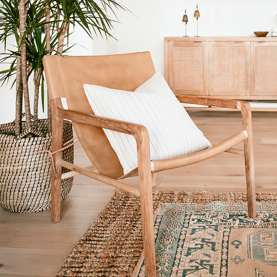 wooden chair with white pillow in living room