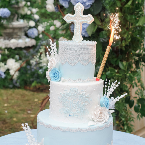 charitable baptism celebration blue and white three tiered cake
