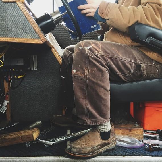 person at wheel of boat salmon fishing alaska